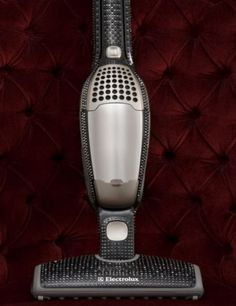 Vacuum cleaner encrusted with Swarovski crystals ...I am a bling girl, but a blinged out vacuum cleaner.  Seriously?  ridiculous