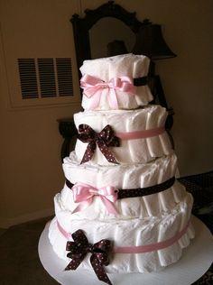 A Homemade Diaper Cake for a girl that I made (i.e. a cake made out of diapers)