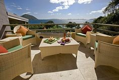 Villa balcony laid with cheese and wine with a view of the sea