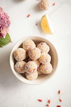 These Raw Lemon Goji Truffles are soft and moist, bursting with sweet coconut, fresh lemon juice and tangy goji berries. A quick-as-a-flash healthy treat. Raw Desserts, Healthy Dessert Recipes, Healthy Treats, Raw Food Recipes, Snack Recipes, Cooking Recipes, Healthy Food, Fudge, Goji Berry Recipes