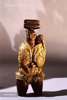 Yooniq images - Woodcarving of an East Greenland woman carrying a baby in the back of her parka