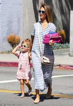 Mother daughter bonding: The 34-year-old actress took her little girl to a birthday party as they coordinated in striped dresses