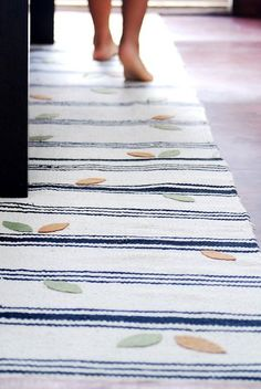 IKEA's SIGNE rugs are a bargain at $3.99 each, and are a durable (and washable) material that's handy for tons of DIY projects. See how easy it is to take one of these simple striped flat-weave rugs and turn it into something else entirely.