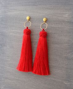~ Lush, silky tassels with a knotted top dangle from a gold hexagon hoop. They are finished with 8mm gold domed post earrings.  Available in: Black White Red Capri Blue Mocha Cream Yellow  and many other colors - please message me with your request for a different color.   Need more? I