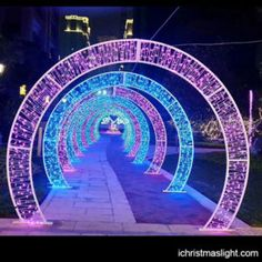 This light tunnel is created with a line of LED light arches. Each arch is wide and tall, with blue and pink color alternately. Christmas Arch, Christmas Lights Outside, Diy Christmas Lights, Christmas Carnival, Christmas Balls, Outdoor Wedding Decorations, Stage Decorations, Outdoor Christmas Decorations, Arch Light