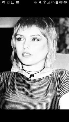 Unusual shot of Debbie Harry sporting a youthful feather cut and looking cute :)