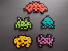 Space Invaders bead pattern. These would make great badges or fridge magnets.