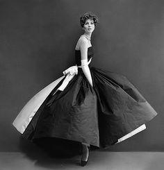 """Suzy, 1956"" by dovima2010 (christine - no longer uploading) | Suzy Parker wearing a black taffeta gown w/ a very full skirt, a white taffeta panel in the back w/ a white taffeta sash by designer Madame Alix Grès | May 5, 2012"