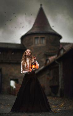 Victorian woman...  medieval casle in the background- photo: Marketa Novak model: Frederika Beranová