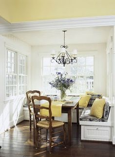 Breakfast nook....yellow ceiling with white walls