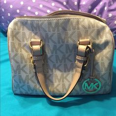 Michael Kors Purse Michael Kors Purse, in perfect condition. I bought it a few months ago and it's just too small for all of my stuff. No trades please. Price is negotiable. Michael Kors Bags
