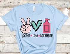Peace love sanitizer t shirt – Heather Aylette Design Funny Tee Shirts, Mom Shirts, Silk Touch, Love Shirt, Love Design, T Shirts With Sayings, Mom Humor, Sports Shirts, Peace And Love