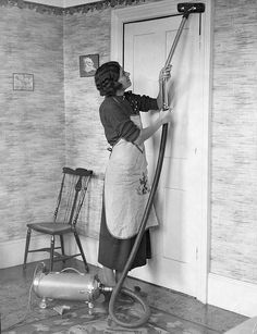 """Vacuuming by MildlyDiverting, via Flickr  """"My Grandmother using an old cylinder vacuum cleaner. Probably takin in the late 1930s, somewhere in Muswell Hill, London."""""""