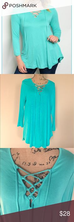 "Mint Plus Size tie tunic top Cute tunic top in a pretty mint color. Cross crossing lace up tie in front, long sleeves, shirt tail style hemline. 95% rayon 5% spandex. Very soft and slight sheen to material. Sizes XL, 2X, 3X.  XL (14/16-bust-21 1/2"", length 30""), 2X(18/20-bust-22 1/2"", length 31""), 3X(22/24-bust-23 1/2"", length 32"") Tops Tunics"