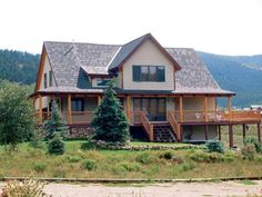 Although this may look like a rustic wood-shake roof, these shingles are of 100 percent recycled materials. Learn more eco-friendly roofing info in MOTHER EARTH NEWS magazine.