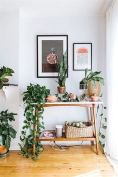 Awesome Swedish inspired vignette with a midcentury modern table styled with plants, and art above The post Swedish inspired vignette with a midcentury modern table styled with plants, and… ..
