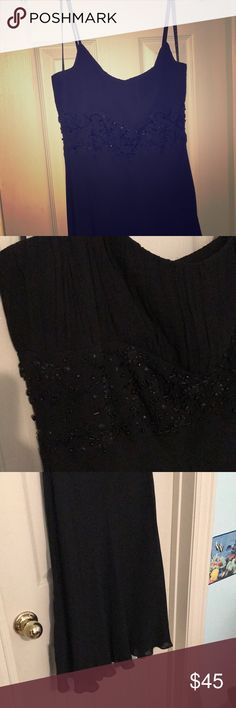 Black Mid Length Formal Dress Size: 6 Elegant Black Midlength Dress. Flares towards the bottom with ripple effect and a beaded waist area with cinched bust area. Worn once! Ann Taylor Dresses Prom