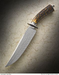 "This feather pattern Damascus blade Bowie with a Stag handle by Master Smith John White was awarded ""Best Bowie"" at the 2013 Blade Show in Atlanta. For more information contact John White johnwhiteknives@gmail.com"