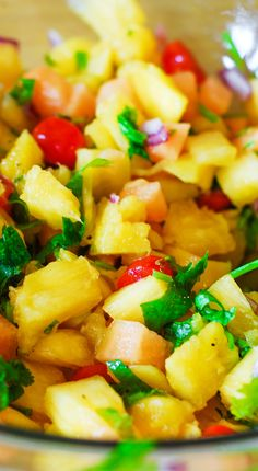 (Latin America) Pineapple mango salsa Not just salsa but a side dish a snack or an appetizer Healthy vegetarian gluten-free and vegan recipe full of fresh tropical fruit and veggies click now for more. Healthy Recipes, Fruit Recipes, Mexican Food Recipes, Appetizer Recipes, Healthy Snacks, Healthy Eating, Cooking Recipes, Ethnic Recipes, Pineapple Recipes