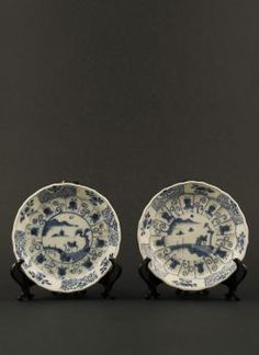 Ca Mau shipwreck saucers. Yongzheng - Two blue and white saucers with landscape, panel, and trellis decor, recovered from the Ca Mau shipwreck dated to 1725