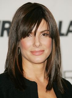 Medium Straight Cut with Bangs   fierce layers with her choppy bangs and shoulder-length 'do.