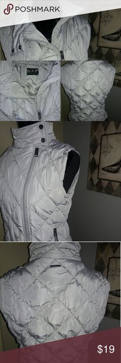Light silver quilted sleevless jacket Slim fitting with snaps on side of neckline to keep warm and a zipper that runs down the side, so when out on the city and its freezing, you can keep warm..And with a long sleeve tunic you will be extra styling...Can be warn with heels or boots to make a fashion statement. Marc New York Jackets & Coats Puffers