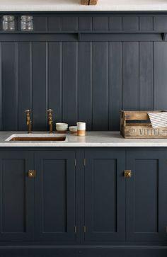 dark-blue-kitchen-with-copper-sink