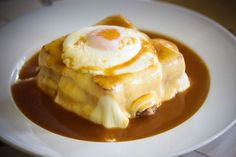 francesinha from Portugal -- dangerous. Steak, sausage, and ham between 2 pieces of white bread, topped with creamy white cheese, spicy red sauce and, last but certainly not least, a fried, runny egg. happiness.