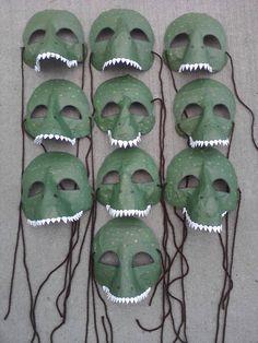 Paper mâché dinosaur masks.