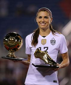 Alex Morgan receiving the Golden Boot and Golden Boot after the SheBelieves Cup Final
