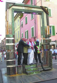 The Peace Frame is part of a cultural exchange between Alabama and Pietrasanta, Italy. From left, Daniele Spina, Pietrasanta minister of culture; Albert Head, executive director of the Alabama State Council on the Arts; Alabama artist Fred Nall Hollis, who created the sculpture seen above; and Pietrasanta Mayor Massimo Mallegni gathered to celebrate.