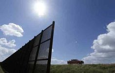 """In this Sept. 6, 2012, file photo, cotton farmer Teofilo """"Junior"""" Flores drives his truck along the U.S.-Mexico border fence that passes through his property in Brownsville, Texas. President Donald Trump's vow to accelerate construction of a """"contiguous, physical wall"""" along the Mexican border is slamming into a Washington reality _ who's going to pay for it and how? (AP Photo/Eric Gay, File)"""