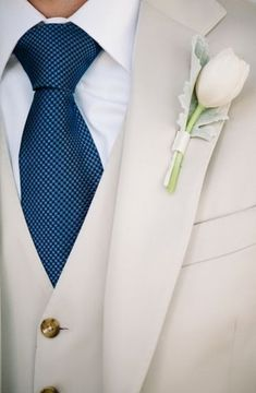 A beautiful blue tie for your groom. Pairs perfectly with a khaki suit for summer.
