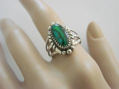 This wonderful vintage Southwestern Navajo sterling ring, presented by JoysShop for consideration, is designer signed G. Martin, and features a lovely malachite cabochon st...