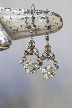 """Vintage assemblage earrings by French Feather Designs. Pot metal and paste jewelry connectors from a 1930's necklace dangld ornate aged brass connectors. Tiny vintage french cut steel beads are hand wired to sterling silver ear wires. Length: 1 1/2"""" from bottom of ear wires."""
