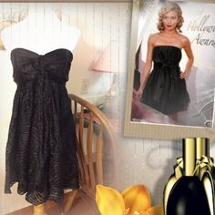 HPMIDNIGHT PASSION EXPRESS STRAPLESS ELEGANCE This little black dress needs no description except sheer beauty and elegance..from the soft sheer layers the elegant flowy material.. Strapless with a tier flowing down the front and a zip entry..SV Express Dresses