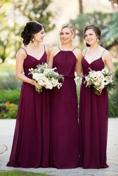 burgundy wedding bridesmaid in burgundy dresses with bouquets