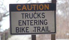trucks entering bike trail