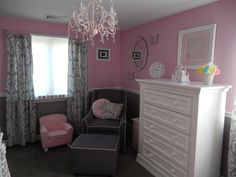 pink and grey baby room...like the curtains and pink chandelier