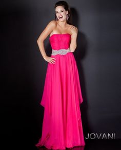 Jovani Style 5306    An elegantly ruched bodice is embellished with a rhinestone detail that culminates in layers upon layers of delicate fabric effortlessly falling to the floor.  Available Colors: Black, Fuchsia, and Royal  PRICE $470AUD
