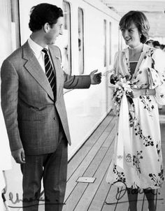 Charles and Diana during their honeymoon on board the Royal Yacht Britannia in 1981. Not their signatures.