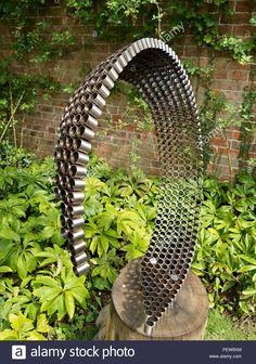 """Wave on Oak"" sculpture in tubular steel by Simon Probyn, Doddington Hall Sculpture Exhibition Lincoln, Lincolnshire, England, UK Stock Photo Metal Art Sculpture, Steel Sculpture, Garden Sculpture, Welding Art Projects, Metal Garden Art, Metal Artwork, Custom Metal, Yard Art, Garden Inspiration"