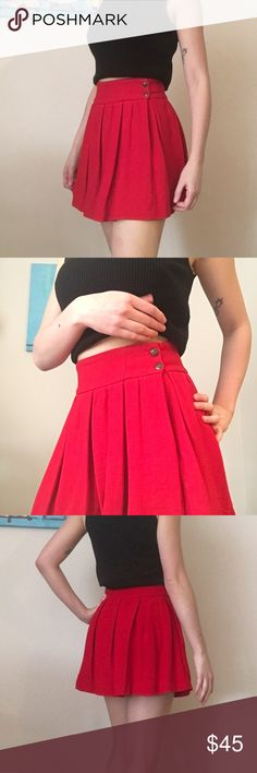 Zara Red Skater Skirt with Uniform Style Buttons Red skater skirt from Zara with two uniform-style buttons on the side. Has a zipper beneath the buttons for easy on and off. Has a pocket on the opposite side. Size XS. Waist measures approximately 14 inches, and skirt measures approximately 16 inches from top of waist band to bottom hem. The fabric label has been cute out for comfort's sake. Zara Skirts Mini
