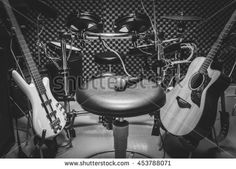 selective focus the  microphone on chair and musical instrument the guitar,electric drum,bass,speakers,background. music production band concept. #453788071