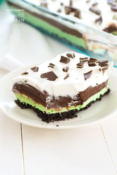 Mint Chocolate Lasagna is a no-bake, one-pan dessert with layers of mint cream cheese, chocolate pudding and Cool Whip on an Oreo crust. Great for St. Patrick's Day dessert.