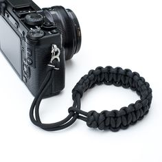 Royal pain to get both the length of the strap and the right number of knots so that when she dropped it (she shoots with her main camera on a cross-torso strap) it would stay on her wrist but not be too tight.