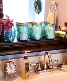 Using the Heritage Collection jars is a colorful way to organize your bathroom toiletries - via Fresh Eggs Daily