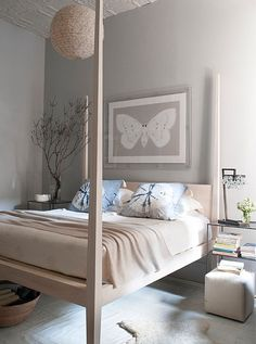 """7 Inspiring Ideas for Above the Bed - 3. The Principal Artwork  If """"less is more"""" tends to be your guiding decorating philosophy, opt for mounting a single magnificent, oversize piece of art above your bed. One with visual intricacy, such as a busy photograph or a heavily patterned abstract, will have an energizing effect. For something a bit more restful, try a monochromatic work."""