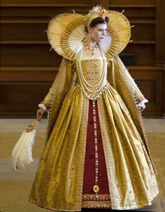 Full image of Elizabethan gold dress with large neck collar.