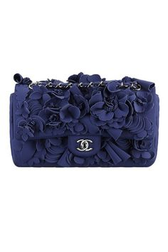 Pretty good accessory purse with the color and detail by Chanel.